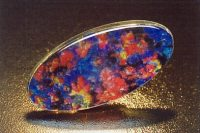 Fig. 15B. A black Gilson™ synthetic opal composite doublet. (Photograph, G. Brown)