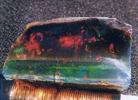 Fig. 7. Black crystal opal from Virgin Valley (USA). (Photograph, P. Brown)
